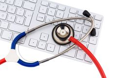 Stethoscope and keyboard of a computer Royalty Free Stock Image