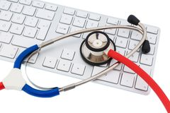 Stethoscope and keyboard of a computer Royalty Free Stock Photos