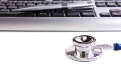 Stethoscope and keyboard isolated on white Royalty Free Stock Image