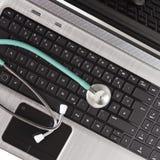 Stethoscope on keyboard Stock Photography
