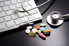Stethoscope on the keyboard. Medicament. And pills Royalty Free Stock Photos