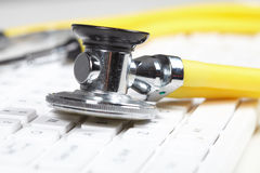 Stethoscope on the keyboard Stock Images
