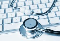 Stethoscope on keyboard Stock Photo