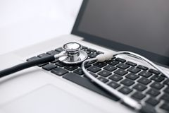 Stethoscope Laid on a Laptop Computer`s Keyboard. Concept of computer health, diagnostics, virus Stock Photos