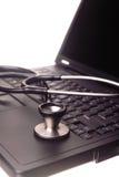 Stethoscope on laptop. Stethoscope resting on a laptop Royalty Free Stock Photos