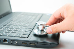 Stethoscope and laptop stock images