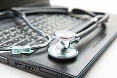 Stethoscope and laptop Royalty Free Stock Image