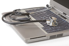 Stethoscope on a laptop Royalty Free Stock Images