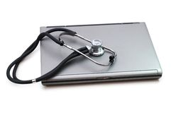 Stethoscope and laptop. Illustrating concept of digital security Royalty Free Stock Photography