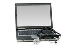 Stethoscope and laptop Stock Photo