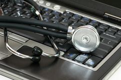 Stethoscope and laptop Stock Photos