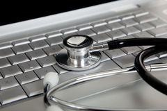 Stethoscope on a Laptop Computer Stock Photos