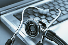 Stethoscope on a laptop computer Royalty Free Stock Photo