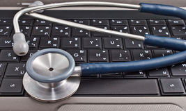 Stethoscope and laptop computer Stock Image