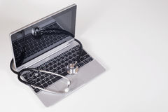 Stethoscope on a laptop computer Stock Photography
