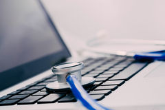 Stethoscope on laptop - Computer repair and maintenance concept Royalty Free Stock Images