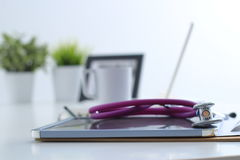 Stethoscope , laptop, folder on the desk in hospital Stock Images