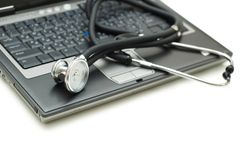 Stethoscope and laptop illustrating Stock Photo