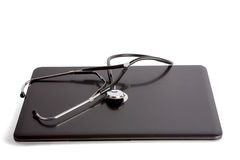 Stethoscope on laptop isolated on white background. Stock Image