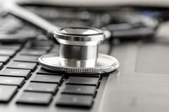 Stethoscope on a laptop keyboard Royalty Free Stock Photos