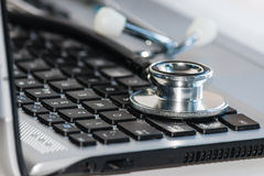 Stethoscope on laptop keyboard Stock Photos