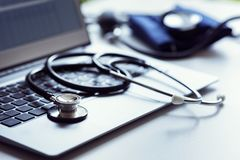 Stethoscope on laptop keyboard in doctor surgery Stock Image