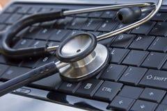 Stethoscope on laptop's keyboard Royalty Free Stock Photos