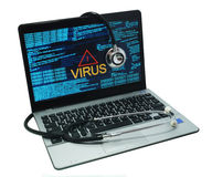Stethoscope on a laptop with virus. Stethoscope lying on laptop. Laptop infected by virus Royalty Free Stock Photo
