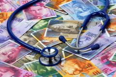 Stethoscope, lies on the Swiss franc. Swiss Franc and stethoscope as a symbol of health costs Royalty Free Stock Photos