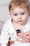 Stethoscope listening to a baby heart beat. Portrait of a young child whose doctor listens heartbeat Royalty Free Stock Images