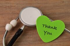Stethoscope and love shape written with THANK YOU