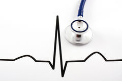 Stethoscope lying on ECG diagram. Macro of stethoscope lying on ECG diagram Stock Images