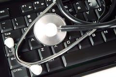 Stethoscope is lying on keyboard Royalty Free Stock Photo