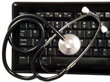 Stethoscope is lying on keyboard Royalty Free Stock Photos