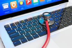 Stethoscope lying on laptop Royalty Free Stock Photo