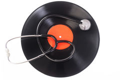 Stethoscope lying over vinyl record Royalty Free Stock Photos