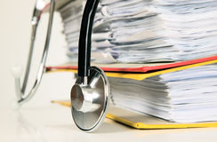 Stethoscope is lying on papers Stock Images