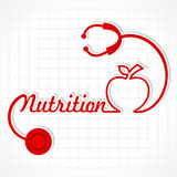 Stethoscope make nutrition word and apple Stock Photography