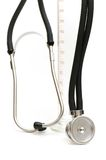 Stethoscope and measuring glass Royalty Free Stock Images