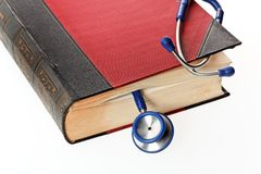 Stethoscope is a medical book. A blue stethoscope liegtn in a medical book Royalty Free Stock Photography