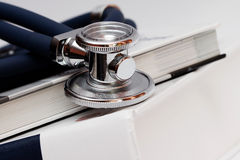 Stethoscope and medical books. Stethoscope; and a stack of books on cardiology Royalty Free Stock Photography