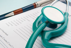 Stethoscope on medical document Stock Photos