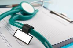 Stethoscope on medical document Royalty Free Stock Image