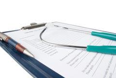 Stethoscope on medical document stock image