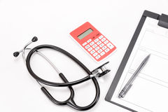 Stethoscope and medical records and Calculator. Royalty Free Stock Images