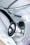 A stethoscope on the medical reference book Royalty Free Stock Photography