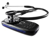 Stethoscope and mobile phone Royalty Free Stock Photo