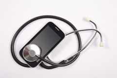 Stethoscope on mobile phone Royalty Free Stock Photo