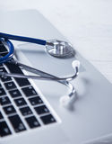Stethoscope with a modern laptop. Stock Photography