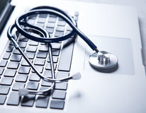 Stethoscope with a modern laptop. Stock Images